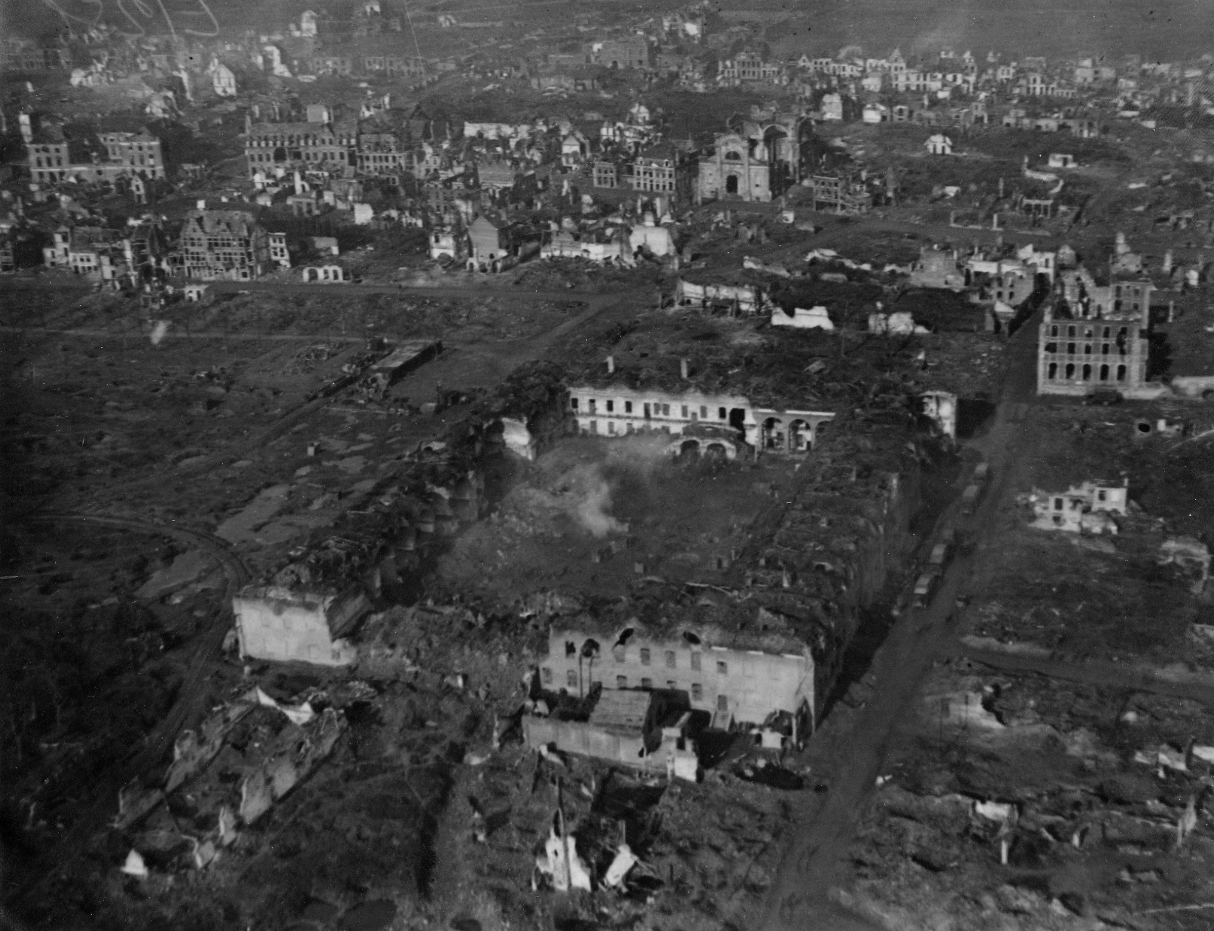 The ruins of Ypres, in Belgium, viewed from an observation balloon. In the centre of the picture can be seen the old Cavalry Barracks, at this time being used as billets by the 1st Division.