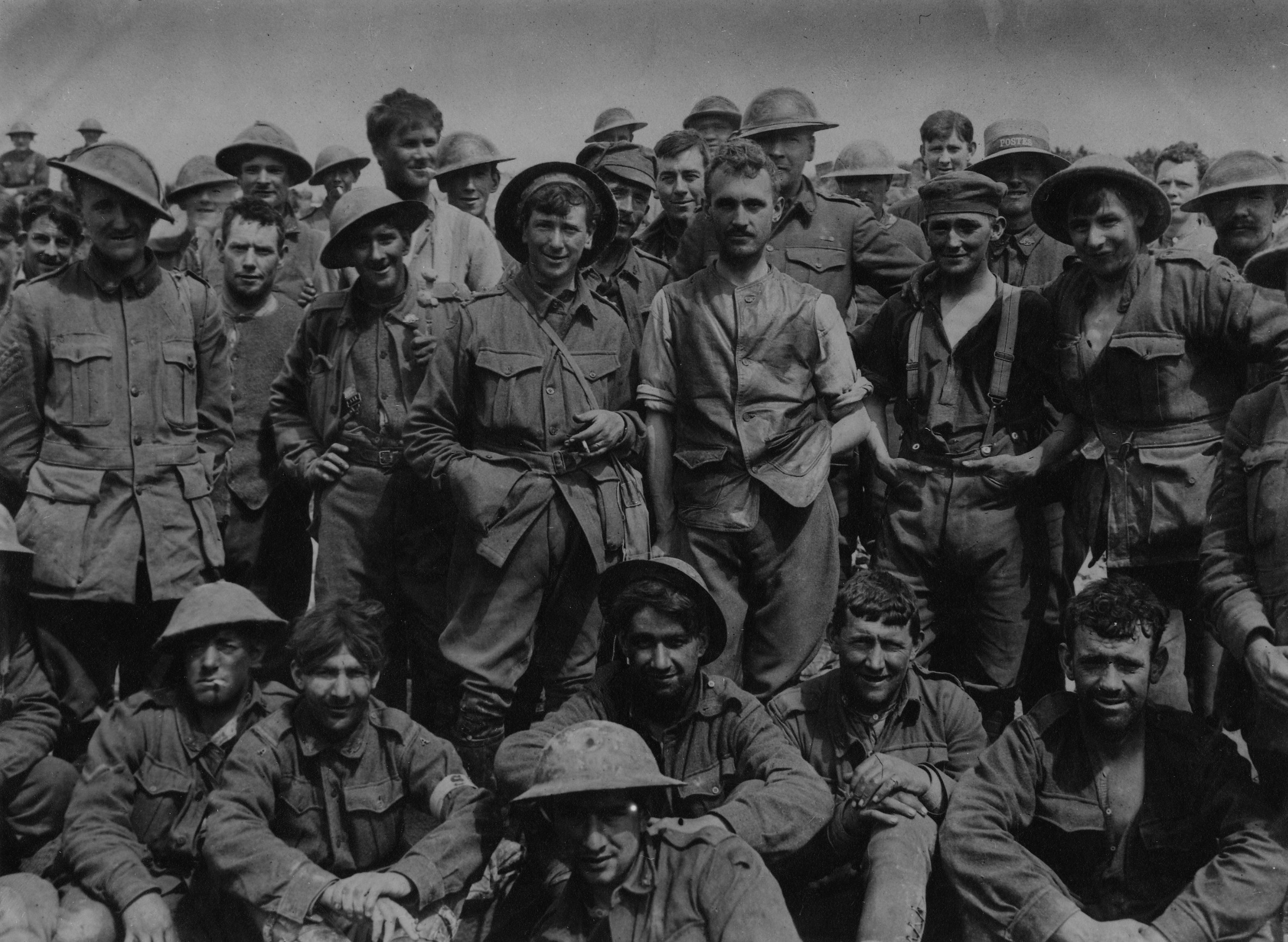 A group of the 46th Battalion just after coming out of the line in front of Monument Wood, where they had experienced a period of very severe fighting, showing the condition of the men after an attack.