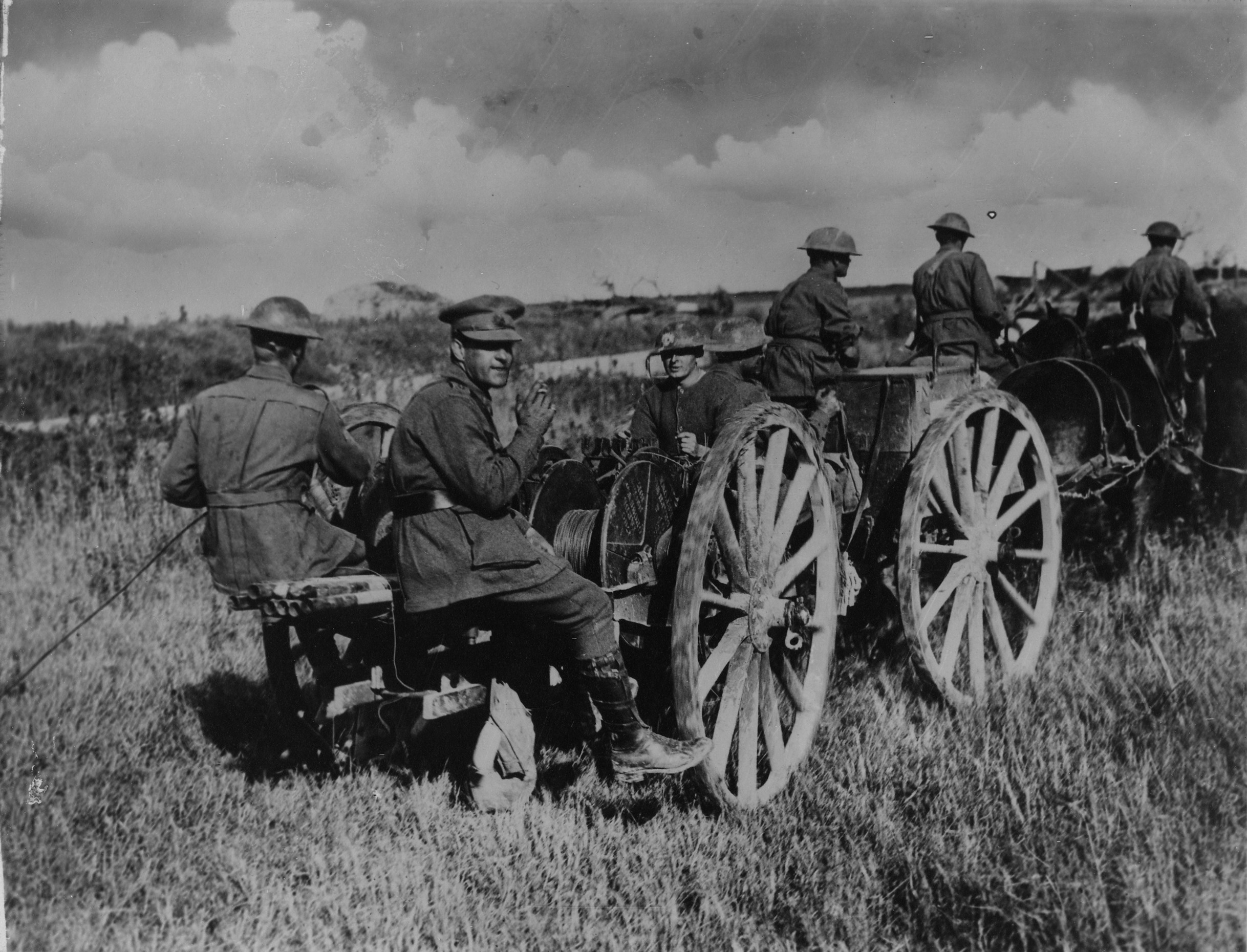 A Cable Section of the 4th Divisional Signal Company laying telephone lines with a cable wagon near Vendelles.