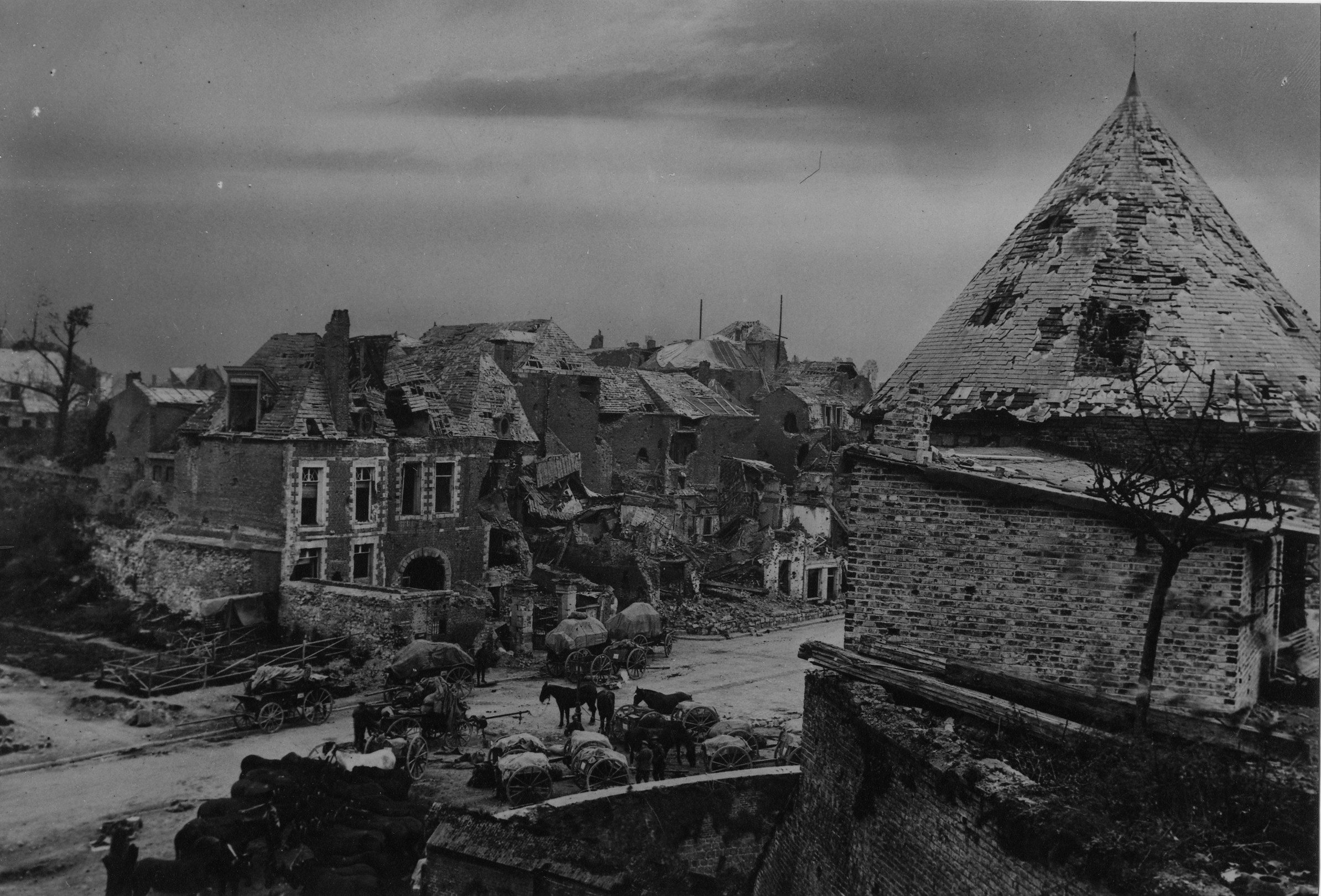 Australian transport halted in a ruined street of Peronne. The shell torn Citadel Tower can be seen on the right. 10-02-1918.