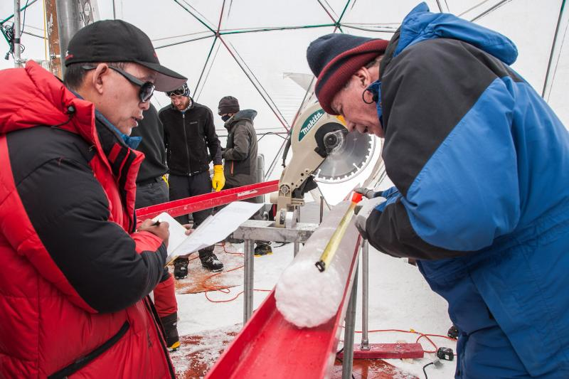 Dr. Yao and Dr. Thompson process an ice core.