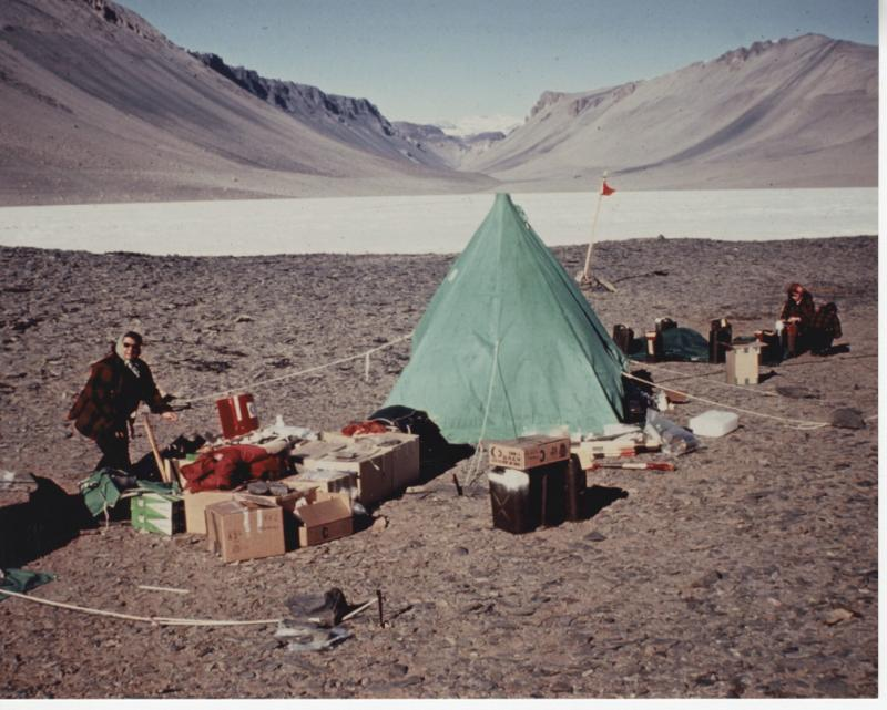 Team members setting up tents and establishing camp in the Dry Valleys of Antarctica