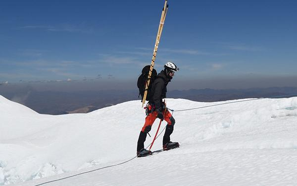 Forrest Schoessow conducting research on a Peruvian glacier.