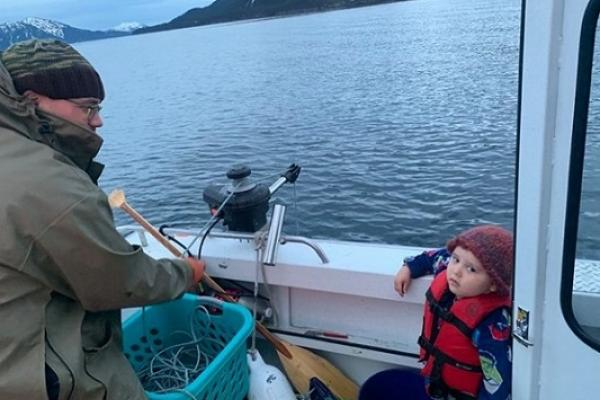 Kaare Erickson and his son while shrimp fishing