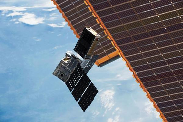 Shoebox-sized CubeRRT satellites being deployed.