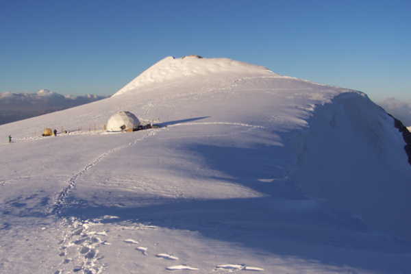 Ice-covered mountain with tent