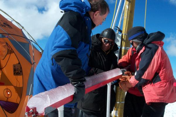 Dr. Lonnie Thompson of the Byrd Center holds an ice core at the summit of Quelccaya, 2003.