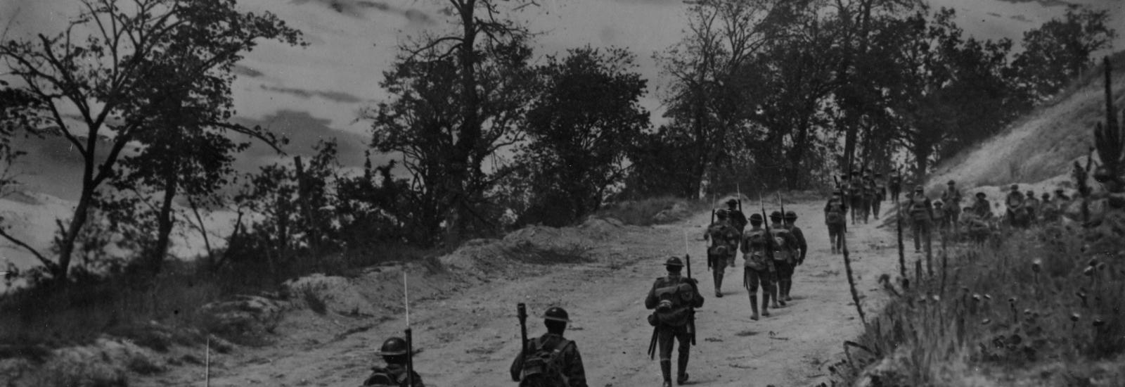 American soldiers walking up the road at Mont St. Quentin. Take note of the bayonets.